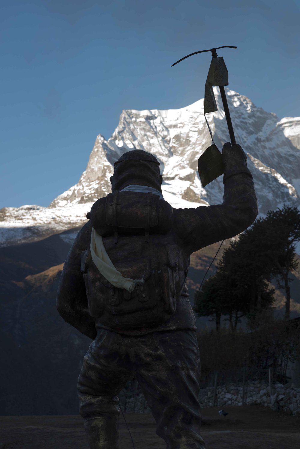 Statue of Sir Edmund Hillary in the foreground.