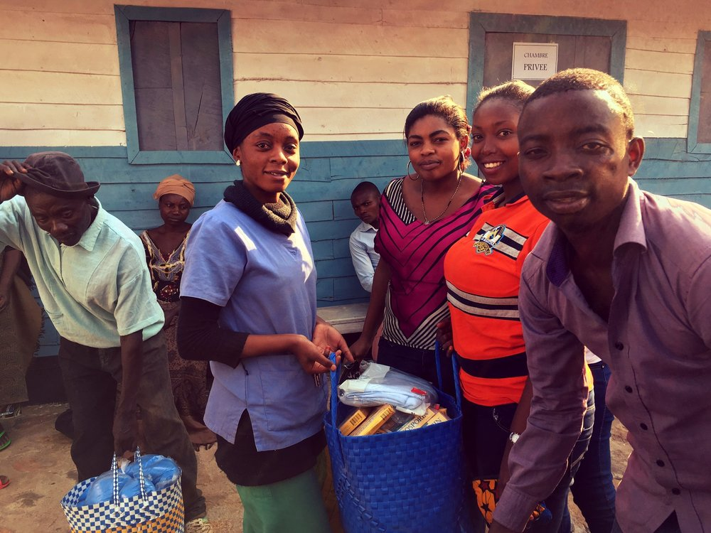 Connecting the girls of Cafe Quotidien with the staff of the Afya Bora Health Center. The girls brought with them supplies from our Channel Initiative community: reusable sanitary pads, Neosporin and more, and pooled their resources to purchase soap, rice and sugar for patients at the clinic. While there, they learned about how the clinic operates, and study-opportunities to join the medical and/or nursing profession.