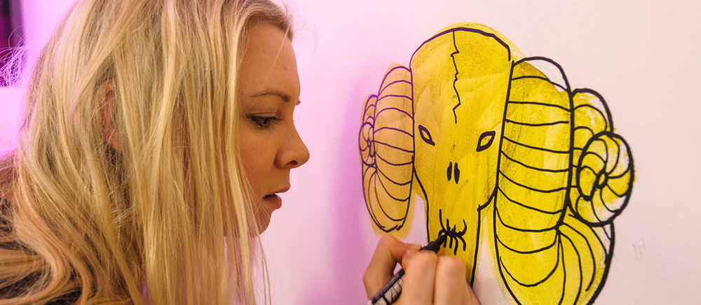 Emmy painting a 'faux-folklore' mural at ustwo studio, London 2012