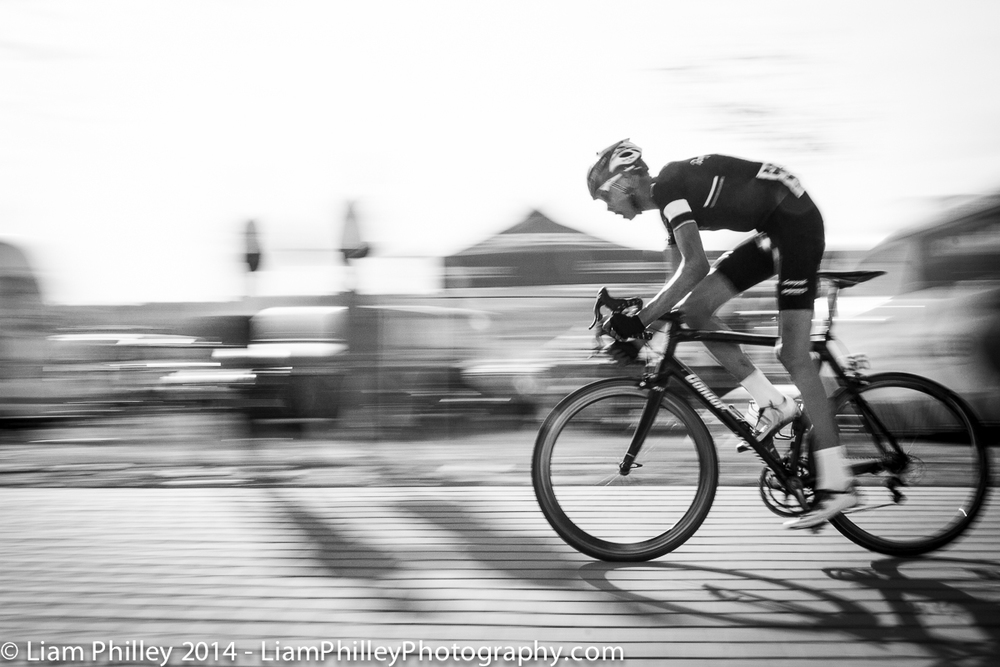 Rapha Condor-JTL - Hugh Carthy giving it at the crit.jpg