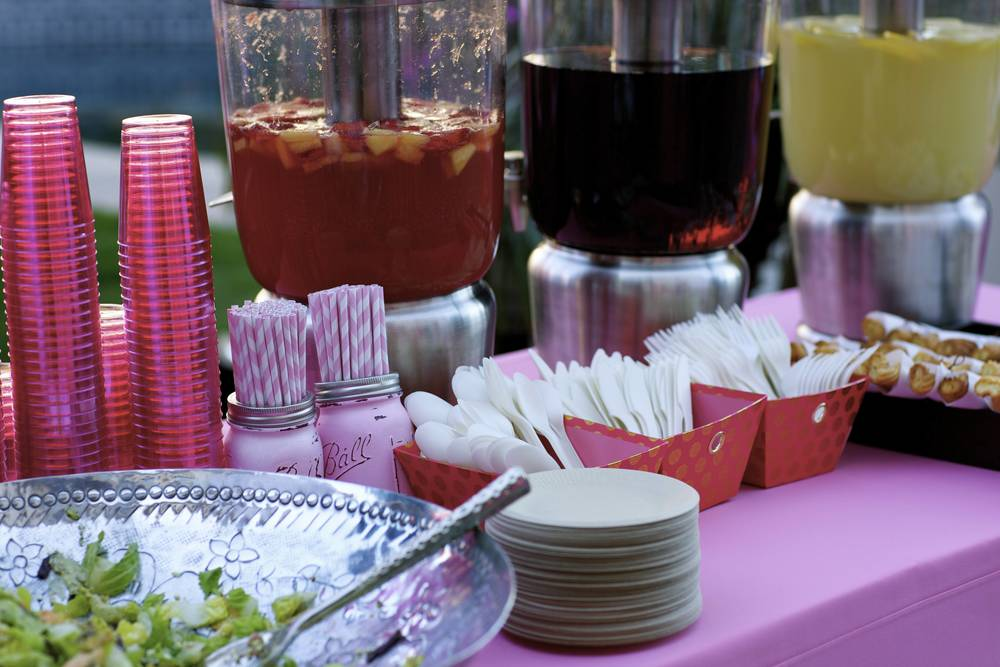 Pink Mason Jars from Drop Cloth Designs Pink Paper Straws from Amazon Beverage Dispenser from Frontgate BGreen Plates from Amazon