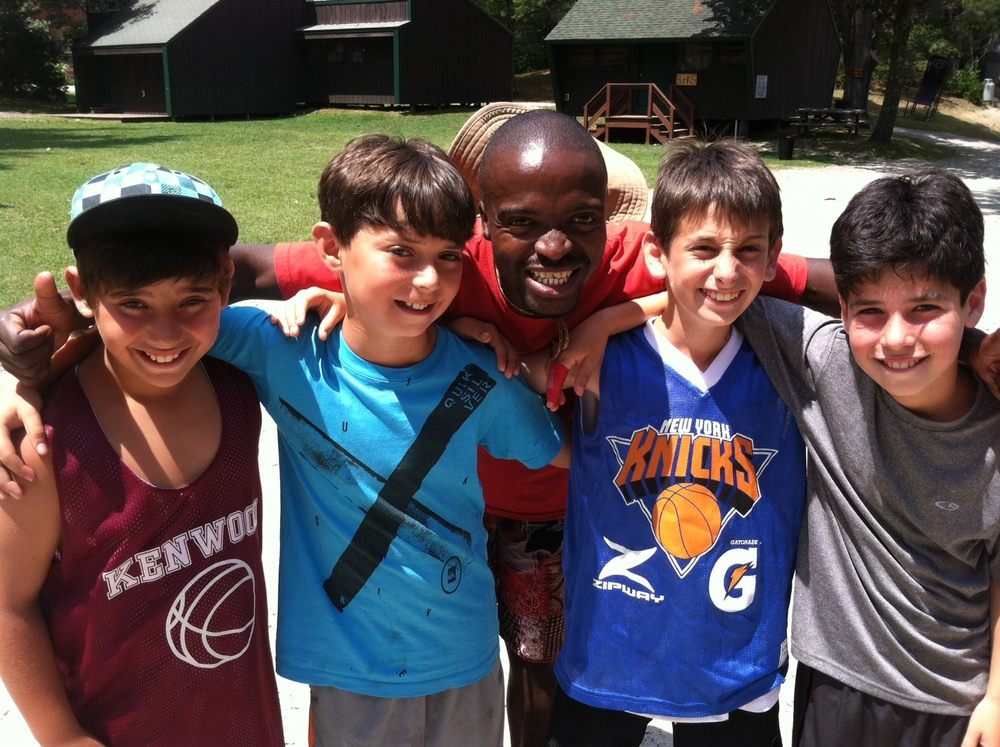 Kgotso with younger campers at Kenwood-Evergreen