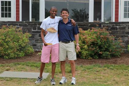 David Miller with Camp Sizanani Director, Kabelo Malefane, in South Africa