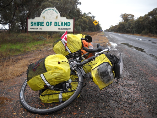 0616+-+on+road+to+west+wyalong+-+shire+of+bland+sign+,+bike+and+road+ahead.jpg