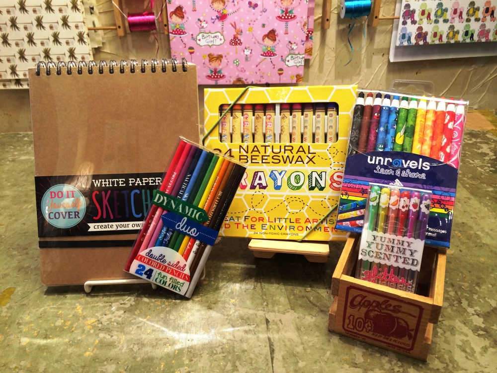 Featured products: white paper sketch book, dynamic duo double sided color pencils, natural beeswax crayons, unravels tear & share crayons (reveal over 30 messages as you unravel!), yummy yummy scented glitter gel pens