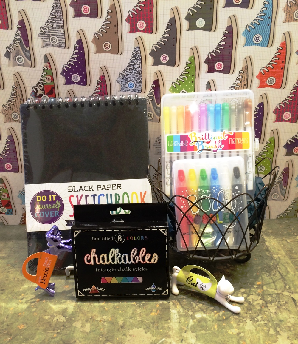 Featured products: black paper sketch book, chalkables triangle chalk sticks, brilliant brush washable markers, body doodlers washable face and body crayons, cat & doxie desk pens