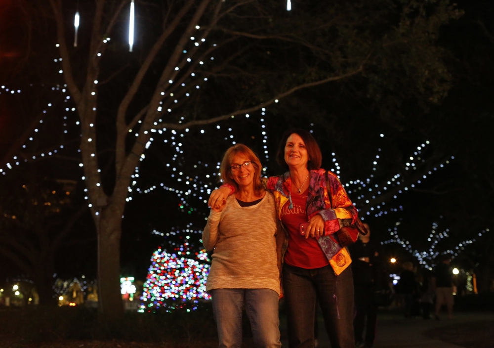 Best friends Maria DiMaggio, from Oregon, and Jill Marie Smith, from St. Petersburg, walk through the holiday display in Straub Park in downtown St. Petersburg on Sunday November 30th, 2014. DiMaggio and Smith have been best friends for 35 years. DiMaggio surprised Smith with a visit for Smith's 60th birthday.