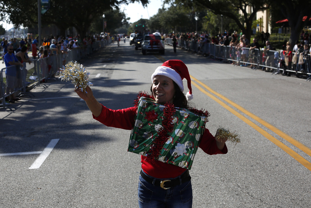 Sandra Peters of St. Petersburg marched in the Santa Parade with girl scout troop 1519 on Saturday December 6th, 2014 in downtown St. Petersburg. St. Petersburg Parks and Recreation brought 65 tons of snow in for the Snowfest event that followed the 88th annual Santa Parade on Saturday morning.