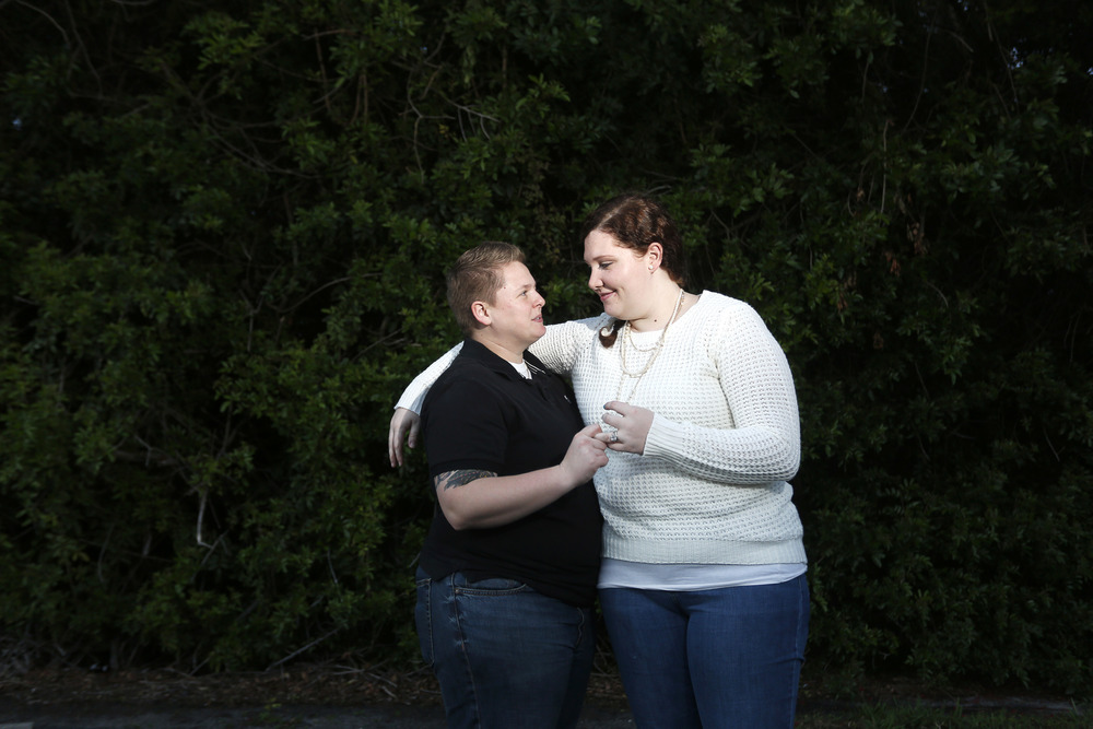 Nicole May, 26, and Amanda Ryan, 24, both of St. Petersburg have been together for 9 years and plan on being one of the first Tampa Bay area couples married on January 6th. They were photographed near their home in St. Petersburg on Sunday January 4th, 2015.