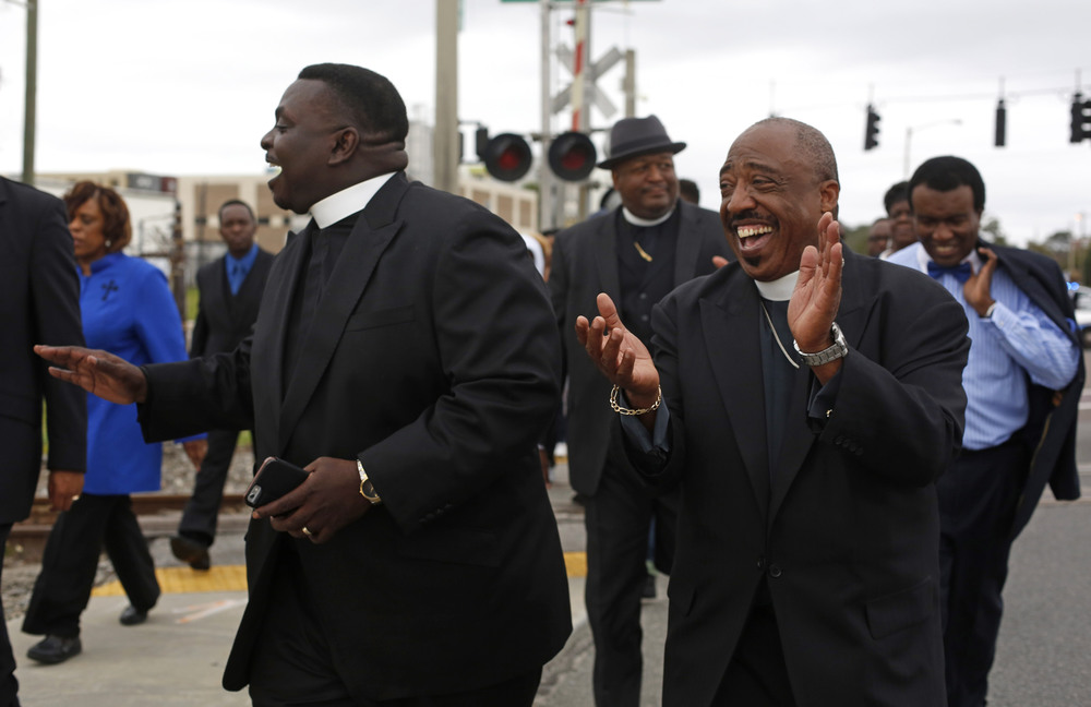 (left to right) Reverend David W. Green Sr, pastor of Allen Temple Church, and Reverend Thomas Scott, pastor of the 34th Street Church of God
