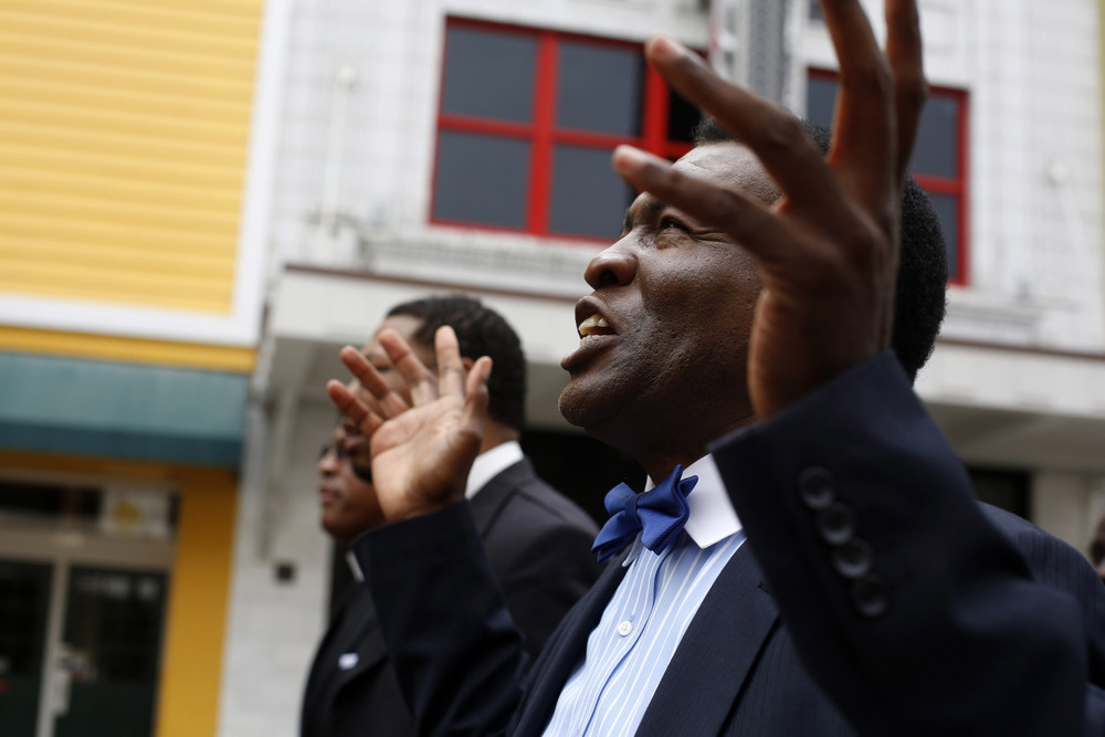"""Pastor Moses Brown, of Tampa. As he marched he started singing a variety of hymns including """"We shall overcome."""""""
