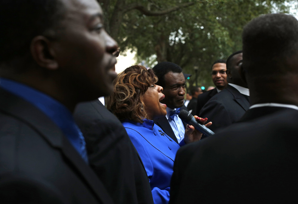 Delores Cain, pastor of Heritage Christian Community Baptist Church of Tampa, sang at Gaslight park after marching nearly 1.5 miles there with clergy members and other people on Thursday January 1st, 2014