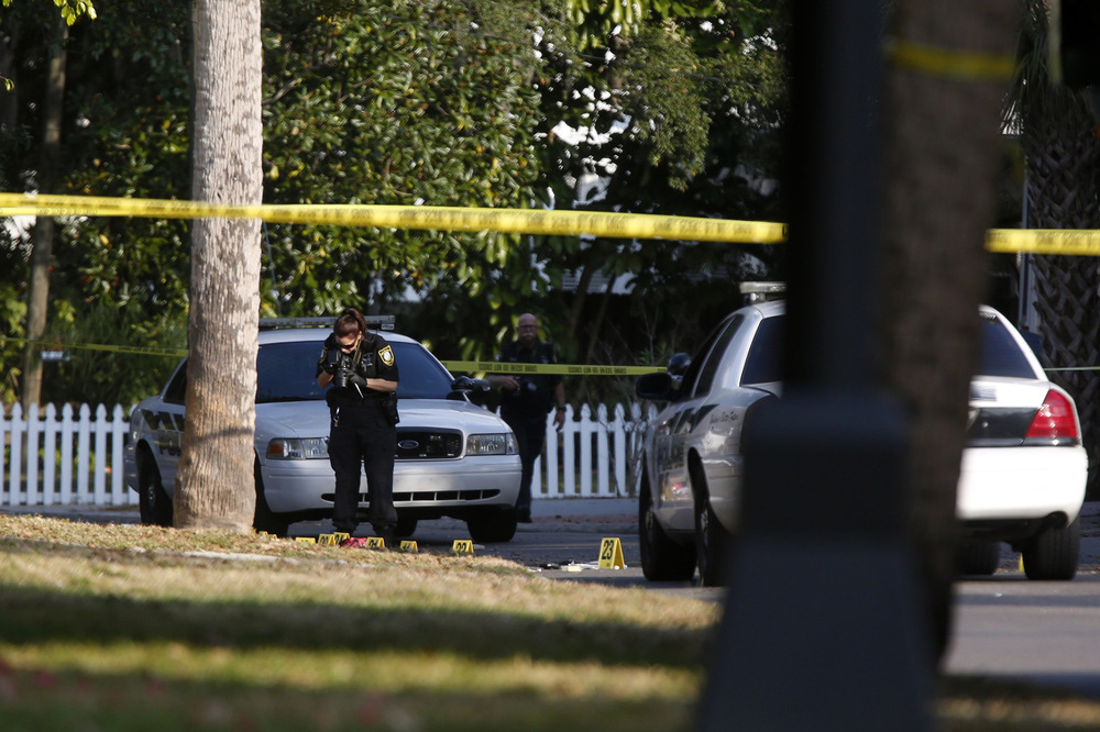 Police officers collect evidence on the scene of the shooting in Tarpon Springs on Sunday morning, December 21st, 2014.