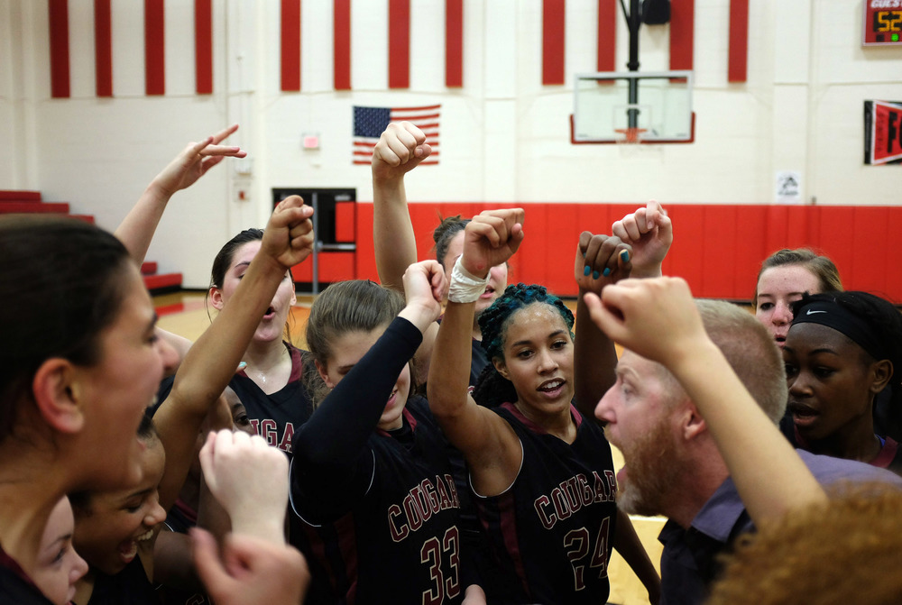 Kellie Gaston (center) celebrates with her teammates after winning the district championship at Northeast High School on Friday January 30th, 2015. Countryside won 52 to 45.
