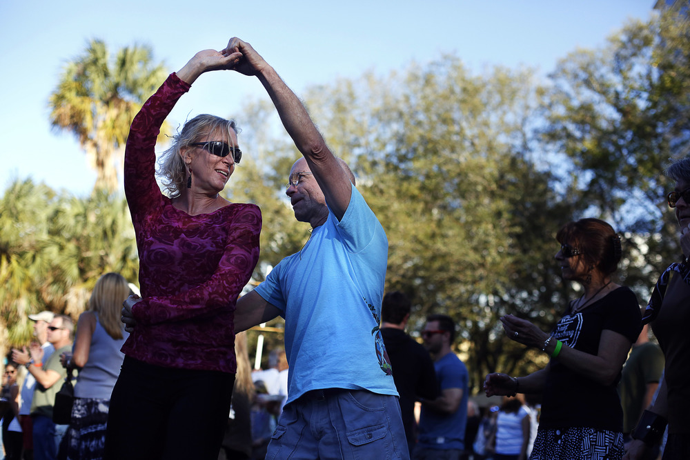 "Teresa Giammarino, of Ozona, and Jay Hoover, of Tampa, swing dance to live music at the bandstand during Localtopia on Saturday February 7th, 2015 at Williams Park in Downtown St. Pete. Localtopia, a ""community celebration of all things local"", featured over 100 St. Pete vendors as well as a craft beer garden, live music, and activities for kids. The 2nd annual festival was held by Keep St. Petersburg Local, an advocacy group and independent business alliance."