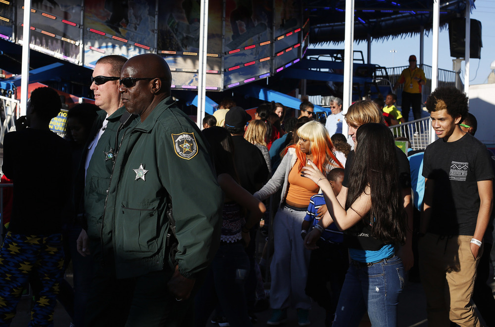 "Hillsborough County Sheriffs deputies (left to right) Eric King and John Footman patrol the midway at the Florida State Fair on Friday February 6th, 2015. The Florida State Fair increased the number of deputies and other law enforcement personnel after last years ""wilding"" event the prompted the HSCO commander on scene to shut down the Fair for fear of public safety."