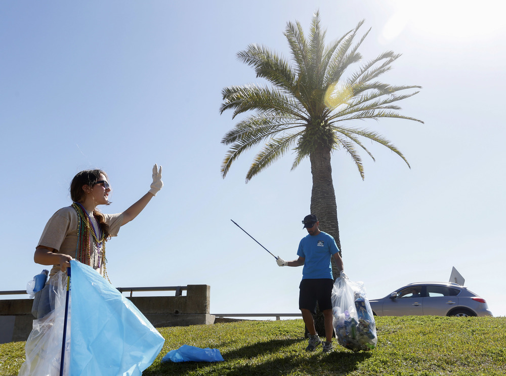 (left to right) Stav Friedman, 25, and Rafael Taveras collect leftover Gasparilla trash near the Davis Islands bridges on Sunday. Friedman is an aquarium volunteer and a Marine Biology student at USF. Volunteers from the Florida Aquarium and other organizations participated in the 5th annual day after Gasparilla clean up on Sunday February 1st, 2015. The volunteers worked in zones along the parade route and the surrounding areas. They identified and tallied what they collected to keep track of the trash data.