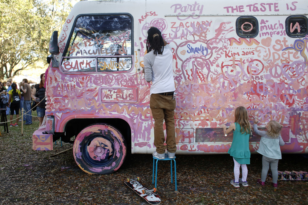 Festival attendees paint on the NOMAD art bus during Localtopia on Saturday February 7th, 2015 at Williams Park in Downtown St. Pete. NOMAD stands for Neighborhood-Oriented Mobile Art + Design. NOMADstudio is a non-profit aimed at making art more accessible to the Tampa Bay Area.