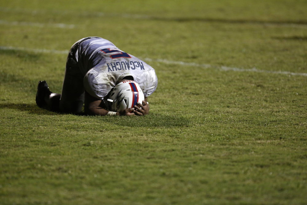 Zeke McGaughy (5), of Indian Rocks Christian, knelt on the ground after losing the game against Admiral Farragut on Friday October 2, 2015 at Admiral Farragut Academy in St. Petersburg. Admiral Farragut won in overtime 42 to 41.