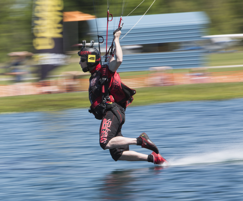 A canopy pilot swoops during the United States Parachute Association (USPA) 2016 National Championships of Canopy Piloting at Skydive City on Friday April 8, 2016 in Zephryhills. In canopy piloting competitions, the skydivers fly a given course over land and water and are judged on speed, distance, and accuracy.
