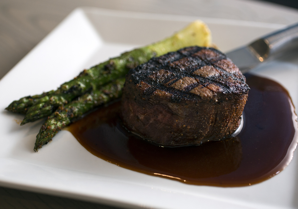 The filet with asparagus and a cabernet reduction at Sacred Pepper in North Tampa