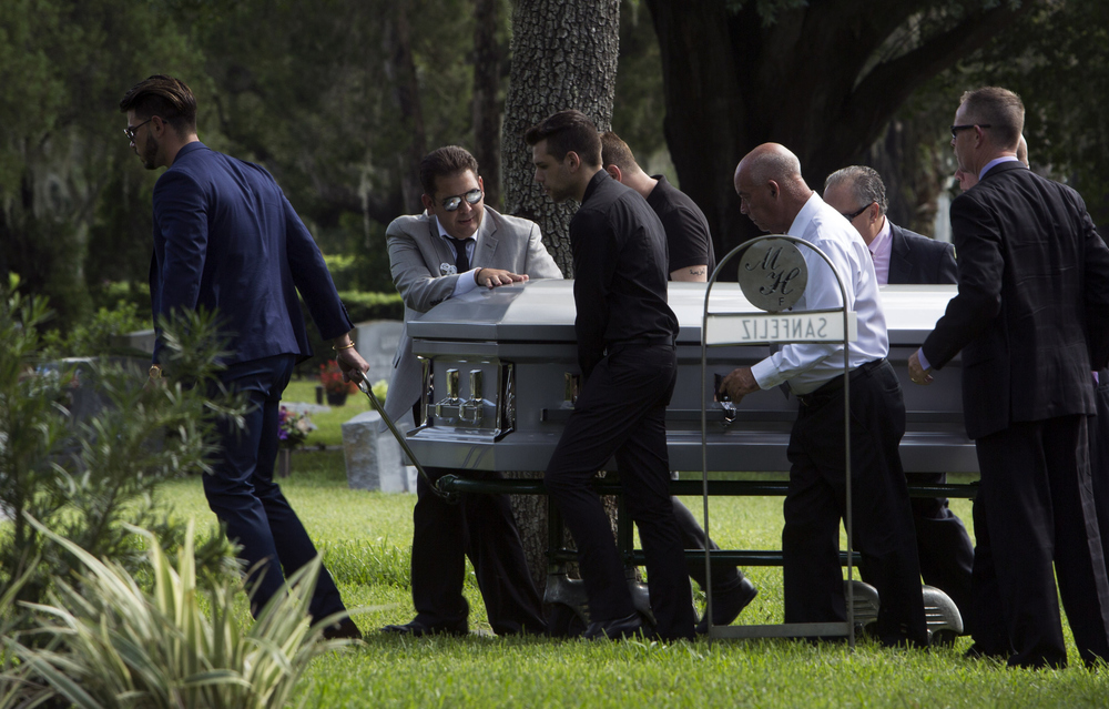 Carlos Sanfeliz (center), Christopher's dad, and others move the casket for the graveside service for Christopher Sanfeliz, 24, at Myrtle Hill Memorial Park in Tampa on Saturday June 18, 2016.
