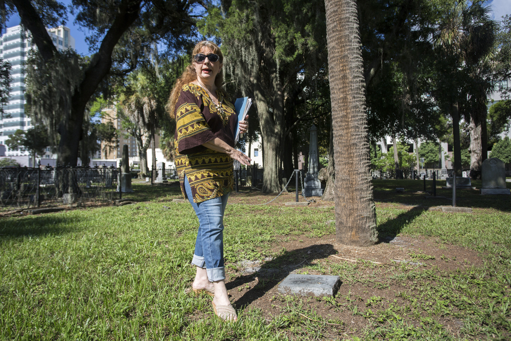 Maureen Patrick, past president of the Tampa Historical Society, talks about replacement grave markers at Oaklawn Cemetery in downtown Tampa on Wednesday June 29, 2016.