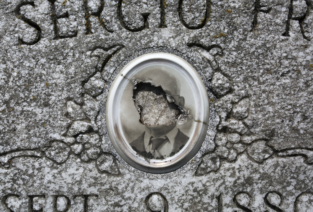 A vandalized gravestone in St. Louis Catholic Cemetery, at Oaklawn Cemetery in downtown Tampa on Wednesday June 29, 2016.  The St. Louis Catholic Cemetery is operated by the Diocese of St. Petersburg.