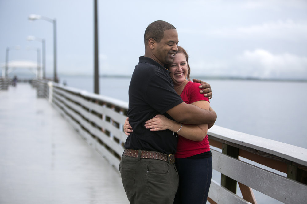Shawn Palmer and Shavon Hyatt, both of Tampa, pose for a photograph during a break in the rain at Ballast Point Park in Tampa on Monday August 8, 2016.  Palmer and Hyatt came out for a walk to avoid traffic before continuing with their day.
