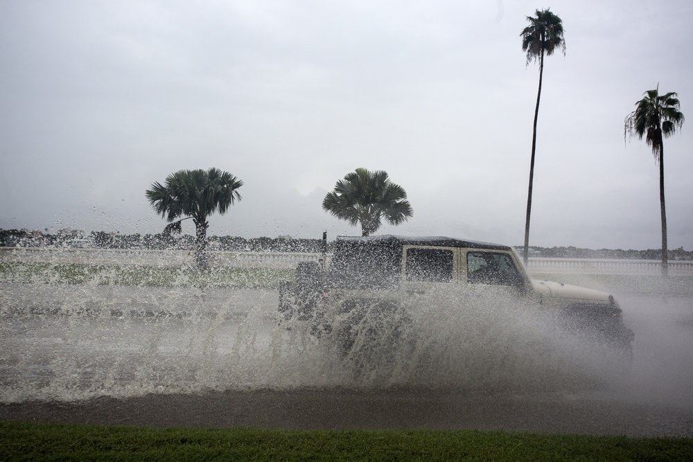 Motorists pass through standing water from rainfall before Tropical Storm Hermine on Wednesday afternoon, August 31, 2016 along Bayshore Blvd in Tampa. Tropical Storm Hermine is expected to make landfall on Thursday, in NW Florida.