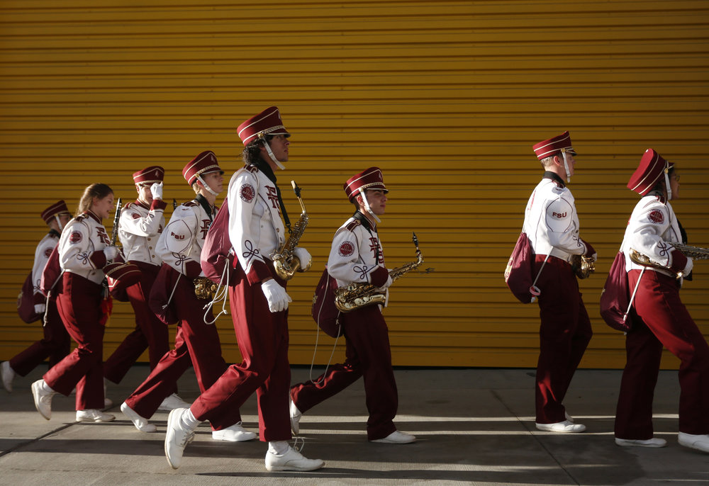 The Florida State Seminoles marching band walks under the stadium before the Camping World Kickoff against the Mississippi Rebels on Monday September 5, 2016 at Camping World Stadium in Orlando, Florida.