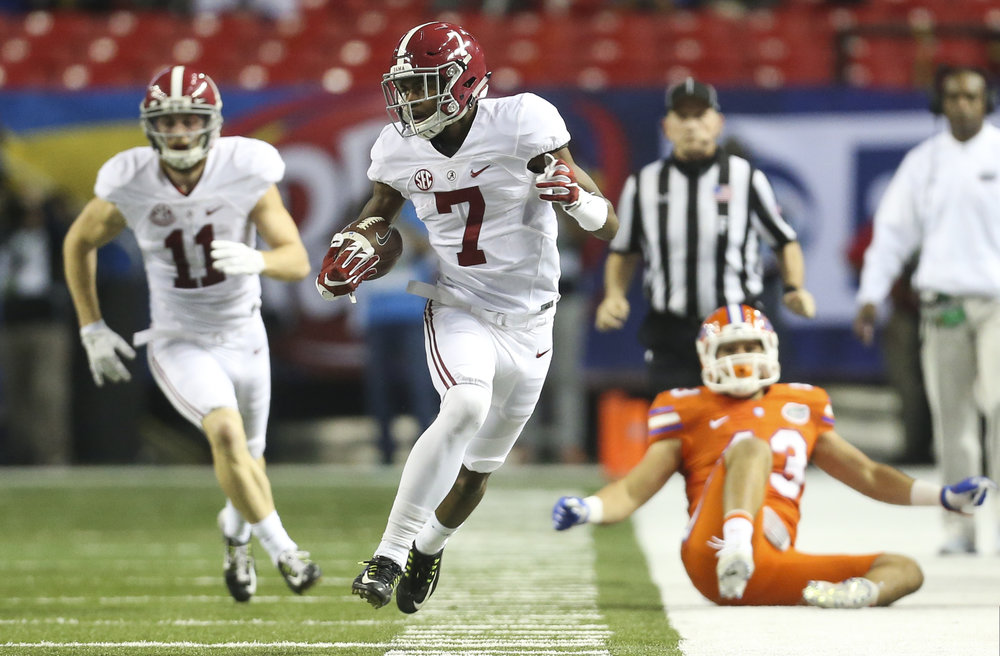Alabama Crimson Tide wide receiver Trevon Diggs (7) makes a 47 yard punt return during the second quarter of the SEC championship against the Florida Gators at the Georgia Dome on Saturday December 3, 2016 in Atlanta, Georgia.