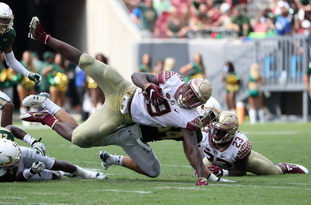 Florida State Seminoles running back Jacques Patrick (9) gets brought down by Florida State Seminoles offensive lineman Alec Eberle (54) during the fourth quarter of the game against South Florida Bulls at Raymond James Stadium in Tampa on Saturday September 24, 2016. Final score FSU 55, USF 35.