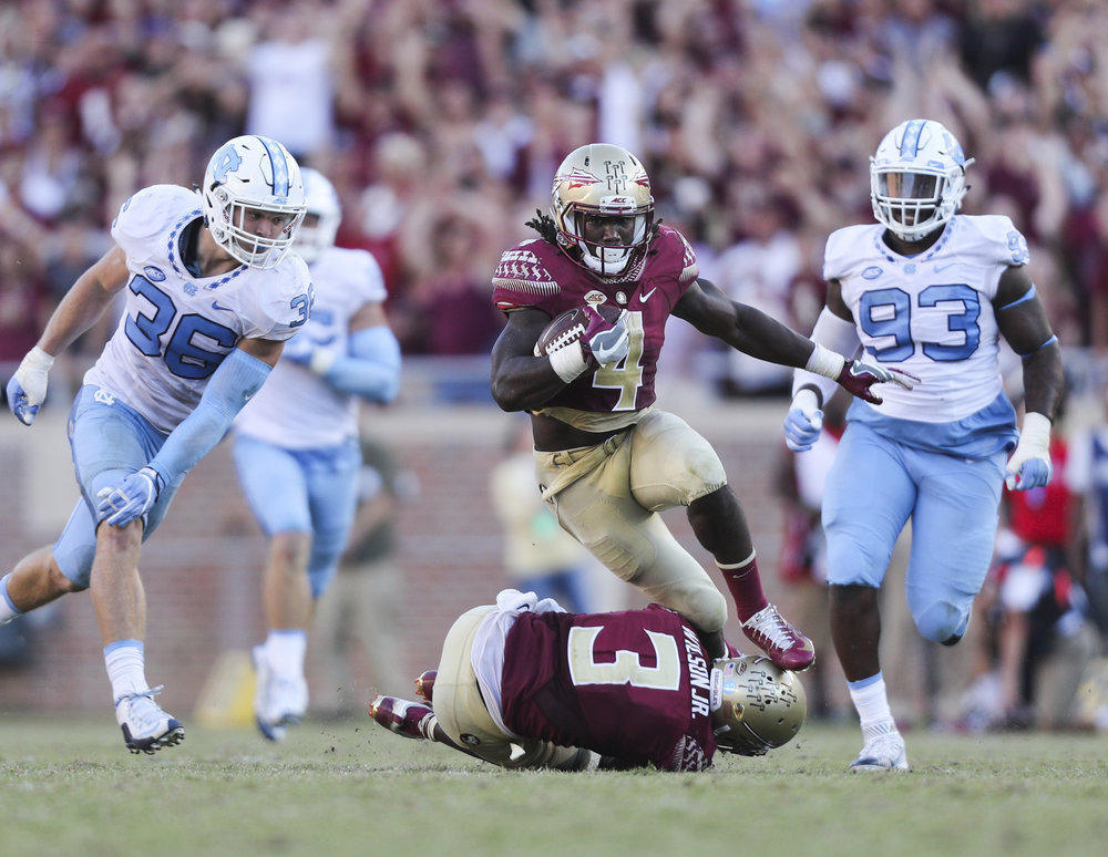 Florida State Seminoles running back Dalvin Cook (4) trips over wide receiver Jesus Wilson (3) after a 41 yard run during the fourth quarter of the Florida State Seminoles game against the North Carolina Tar Heels on Saturday October 1, 2016 at Doak Campbell Stadium in Tallahassee, Florida. The North Carolina Tar Heels defeated the Florida State Seminoles, 37 to 35.