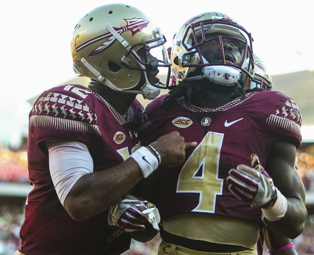 Florida State Seminoles quarterback Deondre Francois (12) celebrates with running back Dalvin Cook (4) after Cook's second fourth quarter touchdown during the Florida State Seminoles game against the North Carolina Tar Heels on Saturday October 1, 2016 at Doak Campbell Stadium in Tallahassee, Florida. The North Carolina Tar Heels defeated the Florida State Seminoles, 37 to 35.