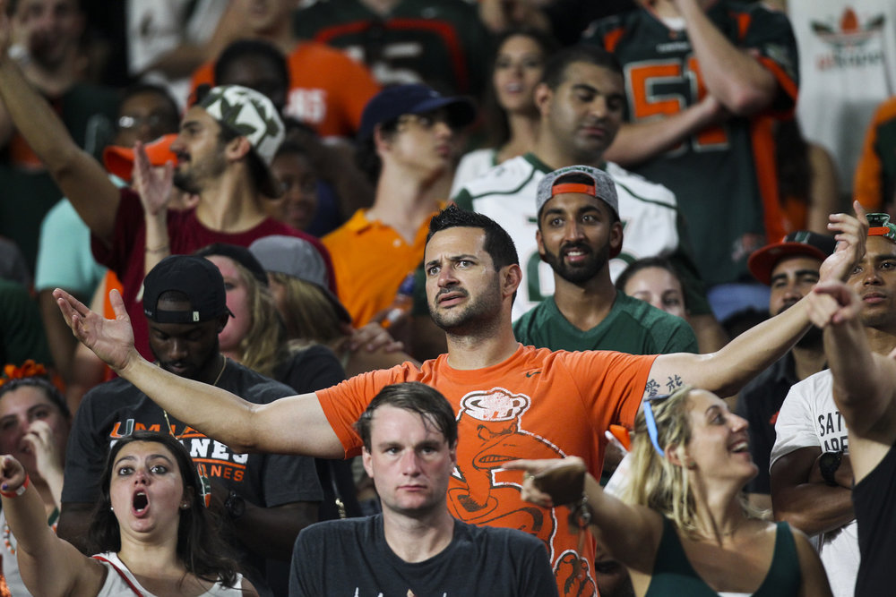 Miami Hurricanes fans react after a kick for an extra point was blocked by Florida State Seminoles causing them to lose the game 20-19 on Saturday October 8, 2016 at Hard Rock Stadium in Miami Gardens.