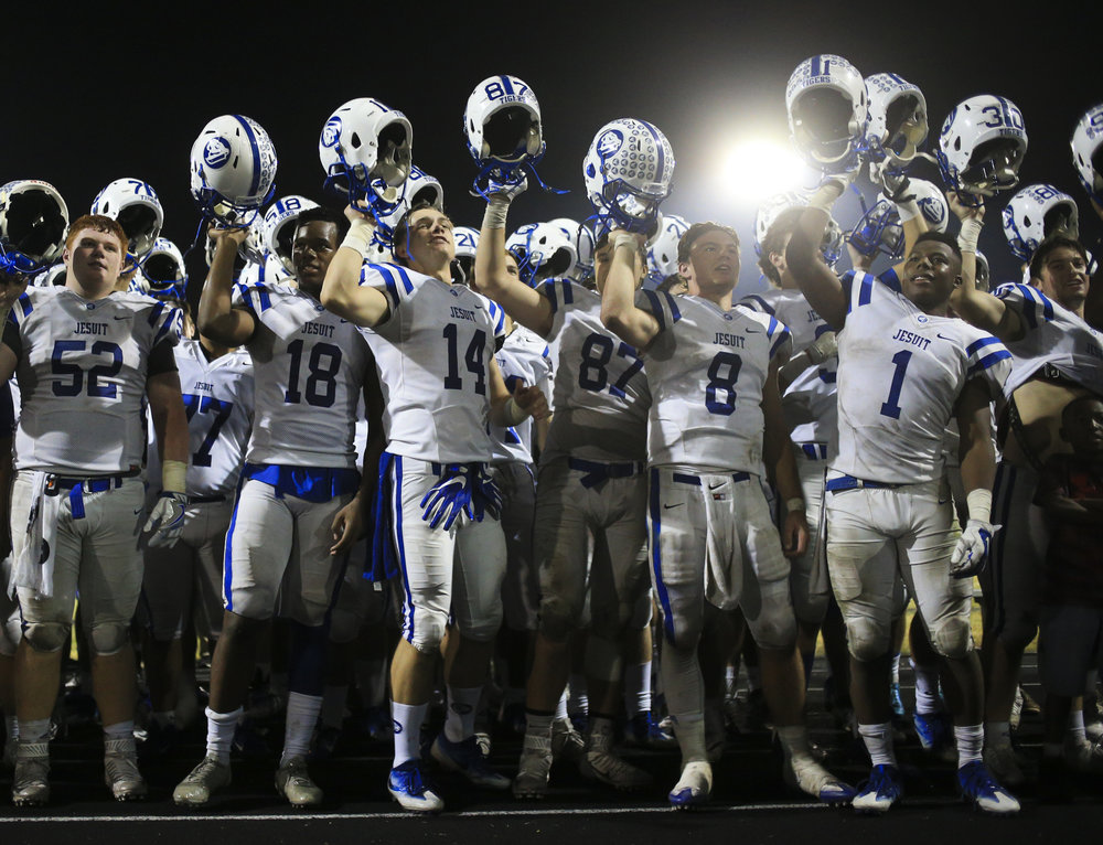 Jesuit High School football players sing the alma mater with fans after the game on Friday November 4, 2016 at Tampa Catholic High School.  Jesuit defeated Tampa Catholic, 34 to 14.