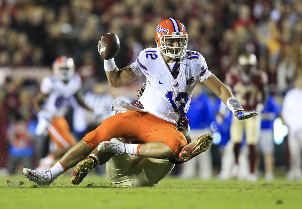 Florida State Seminoles defensive end DeMarcus Walker (44) drags down Florida Gators quarterback Austin Appleby (12) in the fourth quarter of the game between the Florida State Seminoles and the Florida Gators at Doak Campbell Stadium in Tallahassee, Fla. on Saturday, Nov. 26, 2016.