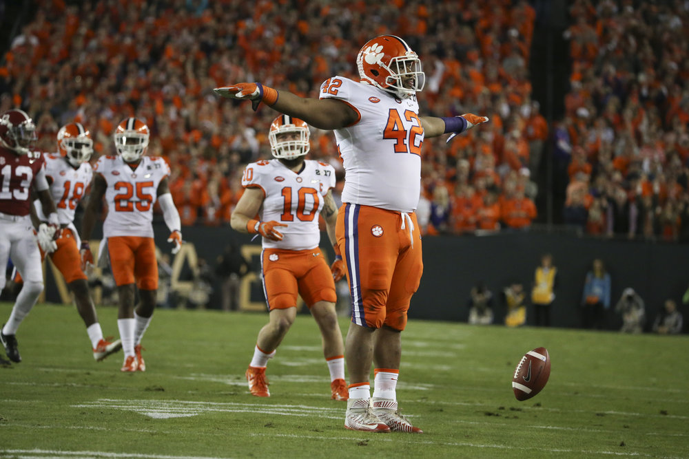 Clemson Tigers defensive lineman Christian Wilkins (42) celebrates breaking up a pass from Alabama Crimson Tide quarterback Jalen Hurts during the first quarter at the College Football Playoff National Championship on Monday January 9, 2017 at Raymond James Stadium, in Tampa, Fla.