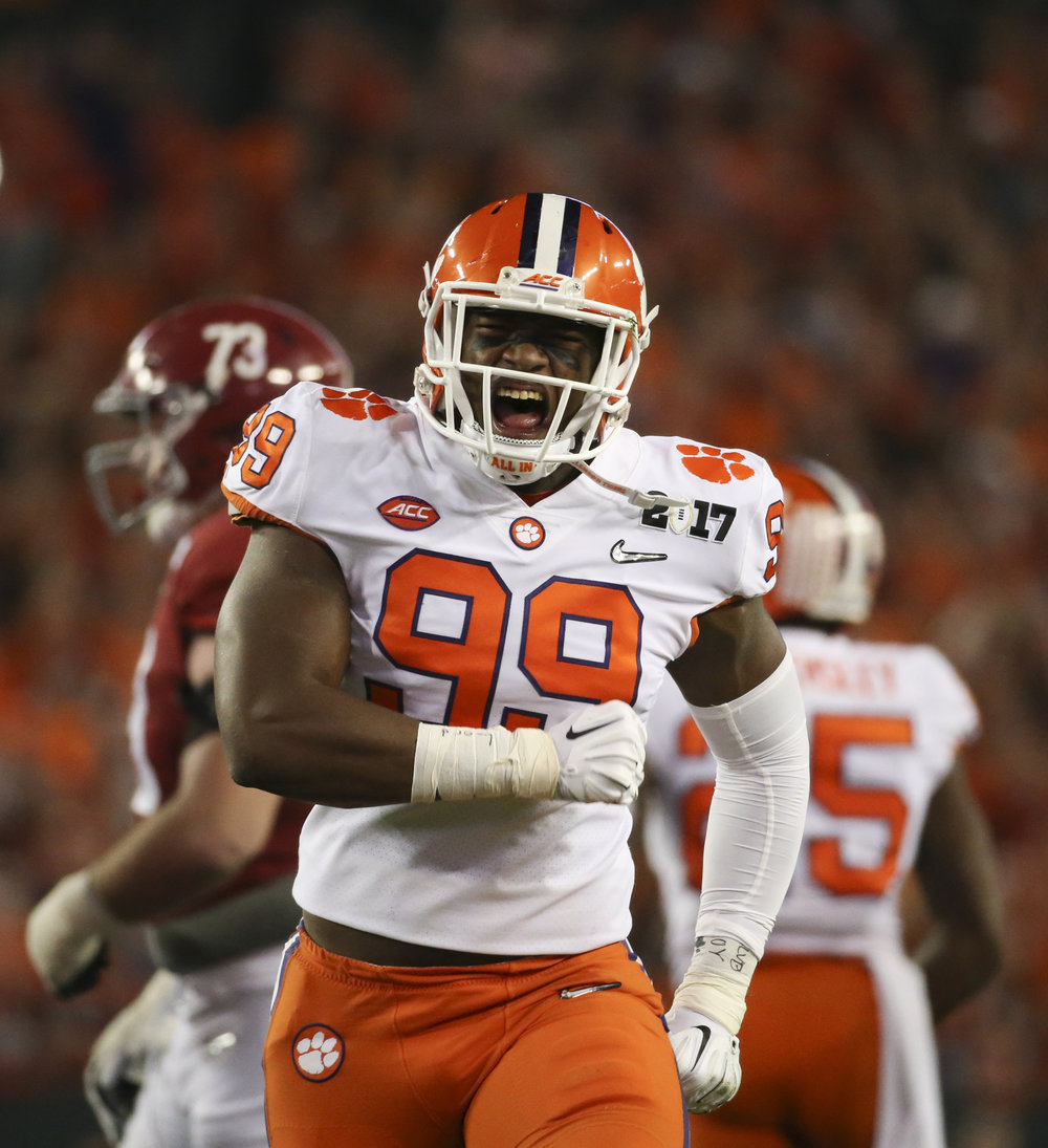 Clemson Tigers defensive end Clelin Ferrell (99) celebrates stopping Bo Scarbrough during the first quarter at the College Football Playoff National Championship on Monday January 9, 2017 at Raymond James Stadium, in Tampa, Fla.