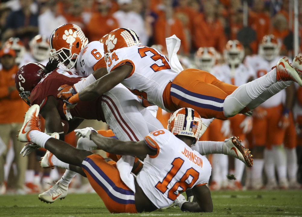 Alabama Crimson Tide running back Bo Scarbrough (9) is stopped by Clemson Tigers during the first quarter of the College Football Playoff National Championship on Monday January 9, 2017 at Raymond James Stadium, in Tampa, Fla.