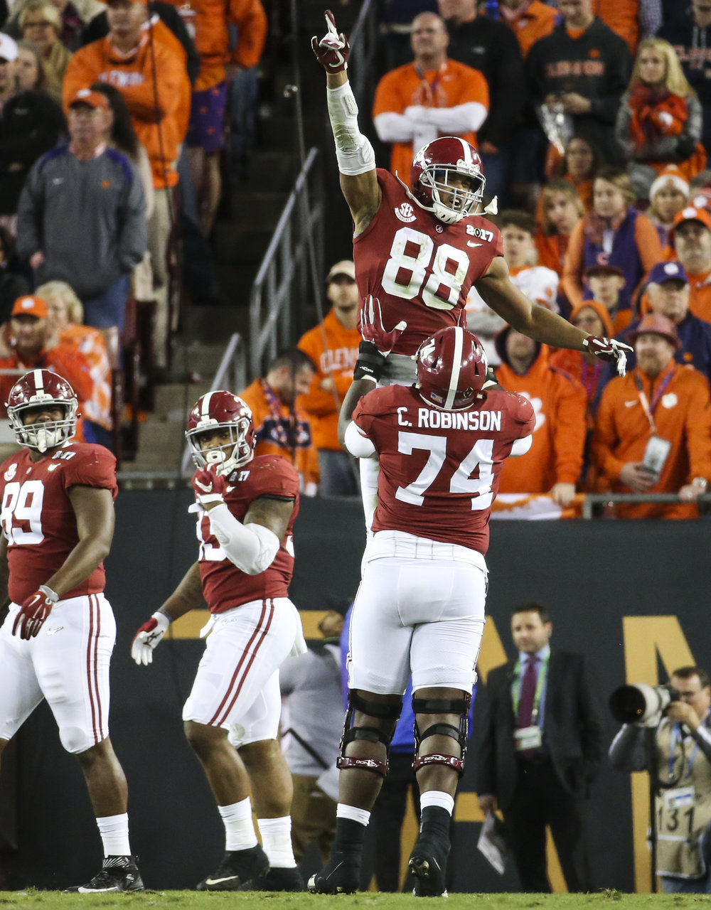 Alabama Crimson Tide tight end O.J. Howard (88) celebrates a third quarter touchdown with offensive lineman Cam Robinson (74) after the College Football Playoff National Championship on Monday January 9, 2017 at Raymond James Stadium, in Tampa, Fla. Clemson Tigers defeated the Alabama Crimson Tide 35 to 31.