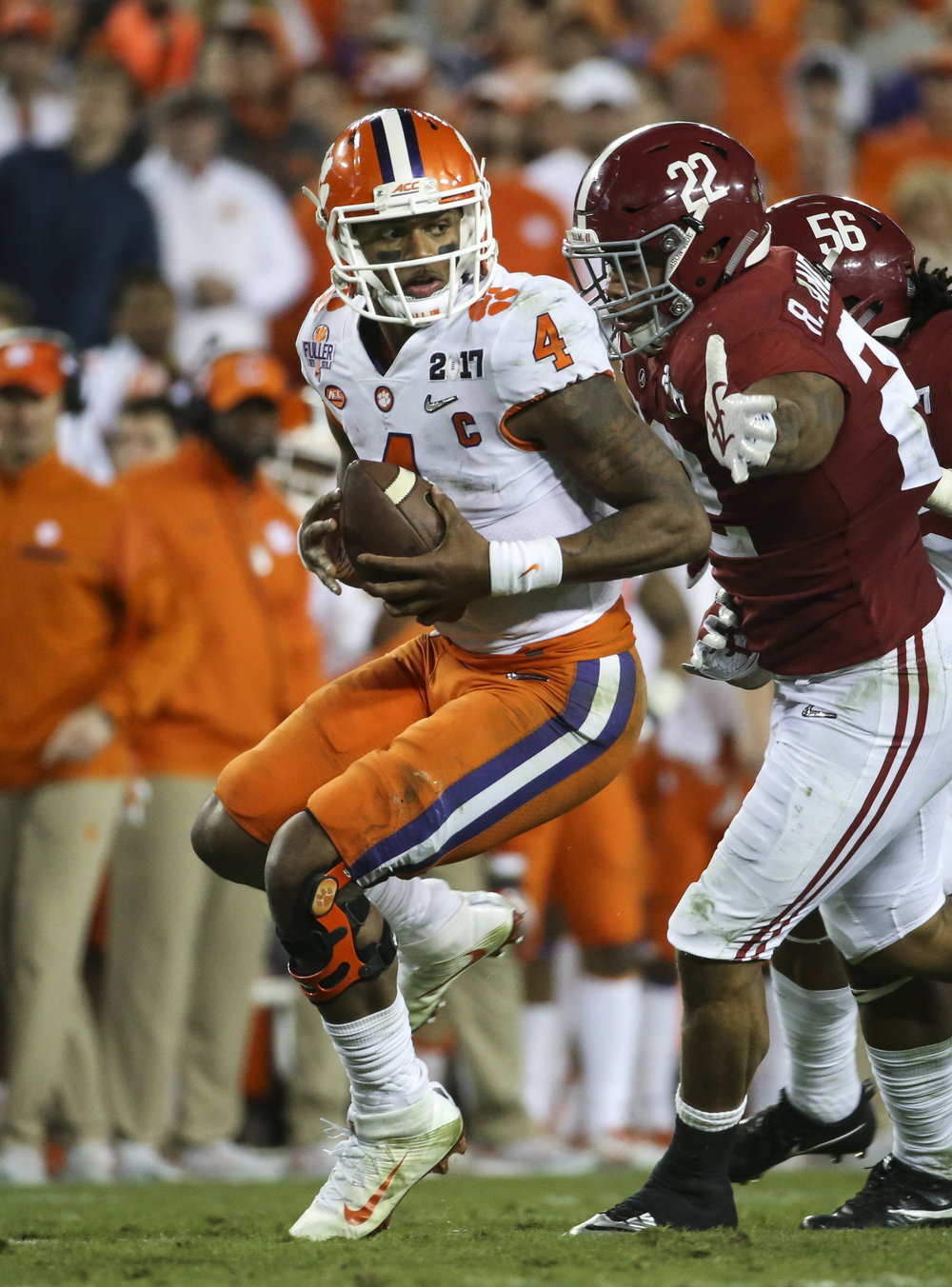 Clemson Tigers quarterback Deshaun Watson (4) escapes  Alabama Crimson Tide linebacker Ryan Anderson (22) and linebacker Tim Williams (56) during the fourth quarter of the College Football Playoff National Championship on Monday January 9, 2017 at Raymond James Stadium, in Tampa, Fla. Clemson Tigers defeated the Alabama Crimson Tide 35 to 31.