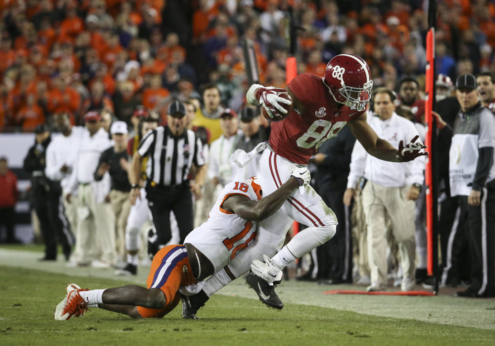 Clemson Tigers safety Jadar Johnson (18) brings down Alabama Crimson Tide tight end O.J. Howard (88) during  the fourth quarter of the College Football Playoff National Championship on Monday January 9, 2017 at Raymond James Stadium, in Tampa, Fla. Clemson Tigers defeated the Alabama Crimson Tide 35 to 31.