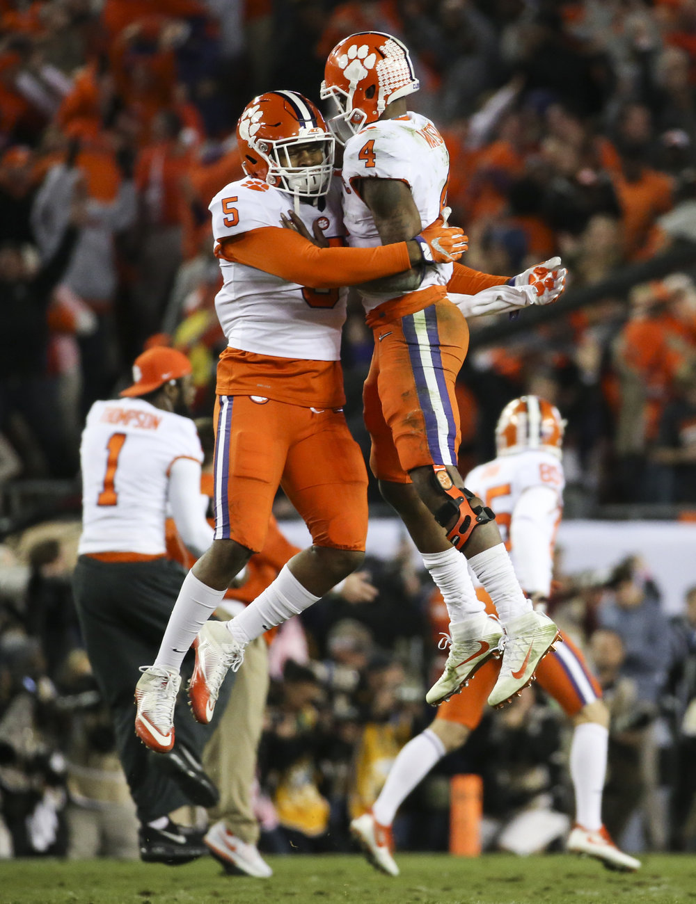 Clemson Tigers linebacker Shaq Smith (5) and quarterback Deshaun Watson (4) celebrate the game winning touchdown during the fourth quarter of the College Football Playoff National Championship on Monday January 9, 2017 at Raymond James Stadium, in Tampa, Fla. Clemson Tigers defeated the Alabama Crimson Tide 35 to 31.
