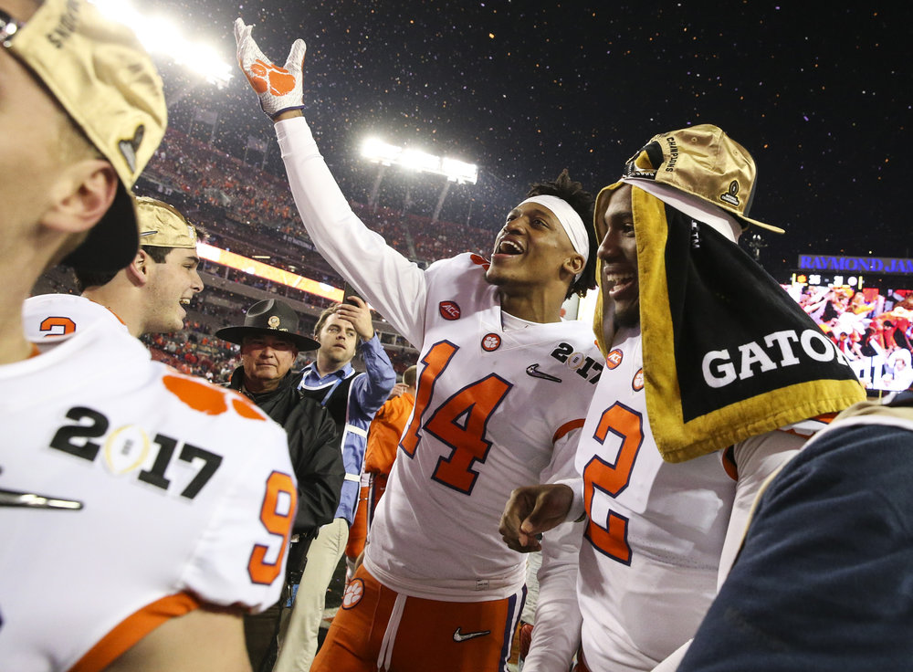 Clemson Tigers wide receiver Diondre Overton (14) and Clemson Tigers cornerback Mark Fields (2) celebrate after the College Football Playoff National Championship on Monday January 9, 2017 at Raymond James Stadium, in Tampa, Fla.