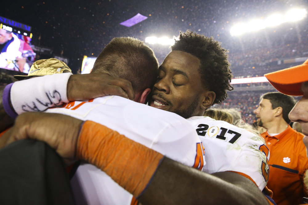 Clemson Tigers defensive end Chris Register (45) and linebacker Kendall Joseph (34) celebrate after the College Football Playoff National Championship on Monday January 9, 2017 at Raymond James Stadium, in Tampa, Fla.