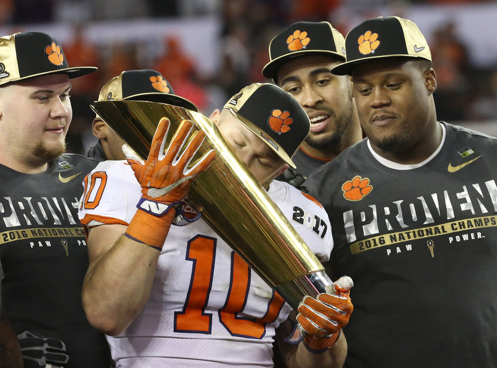 Clemson Tigers linebacker Ben Boulware (10) kisses the championship trophy after the College Football Playoff National Championship on Monday January 9, 2017 at Raymond James Stadium, in Tampa, Fla.