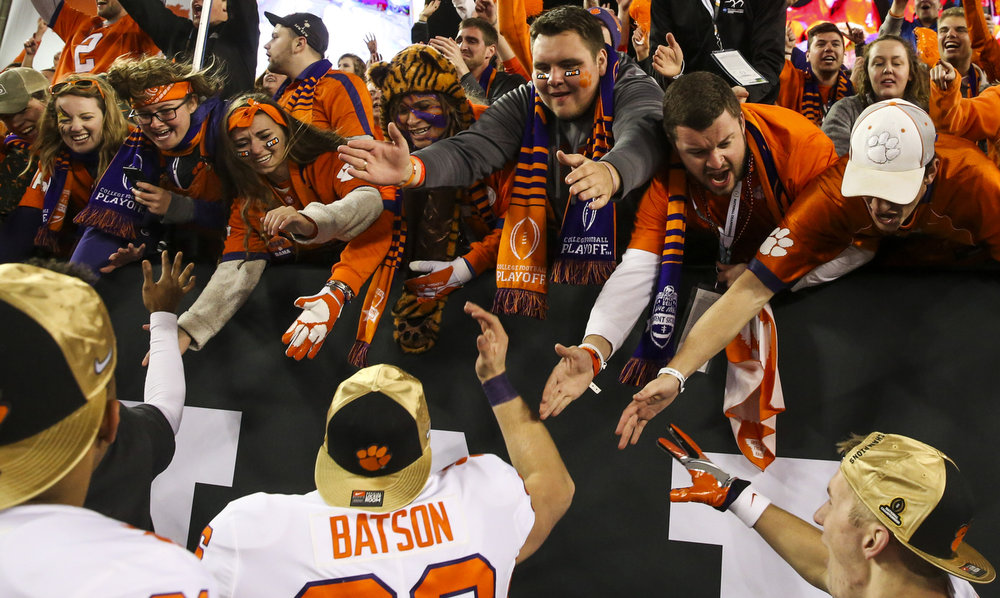 Clemson Tigers fans celebrate with punter Michael Batson (96) after the College Football Playoff National Championship on Monday January 9, 2017 at Raymond James Stadium, in Tampa, Fla.