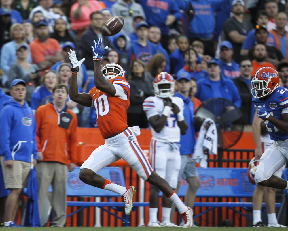 Josh Hammond (10) of the catches a pass during the first quarter of the Orange and Blue Debut at Ben Hill Griffin Stadium in Gainesville, Fla.